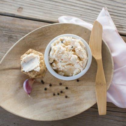 Green Dirt Farm serves garlic peppercorn flavored fresh sheep cheese, similar to ricotta.
