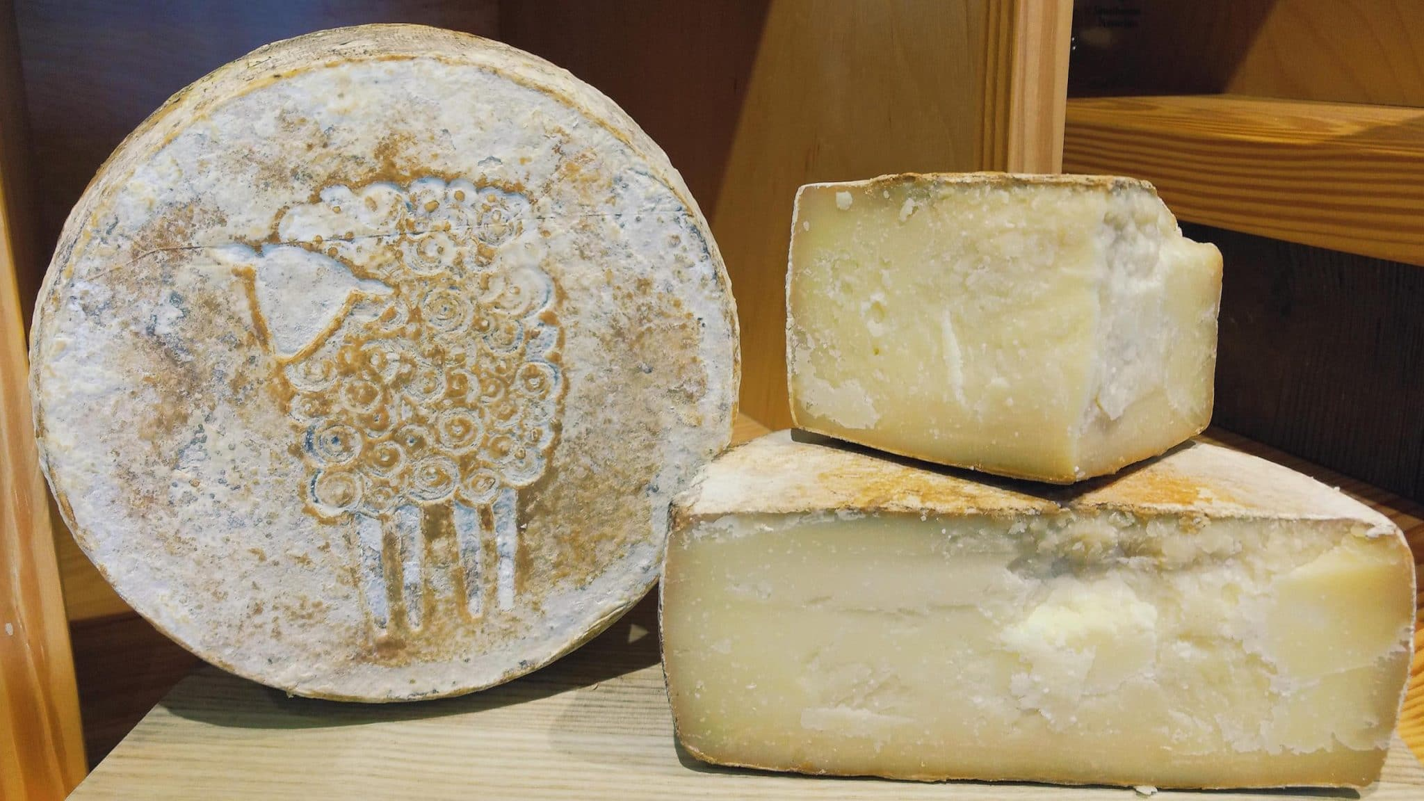 Whole wheel of Prairie Tomme Reserve, aged 100% sheep cheese from Green Dirt Farm.